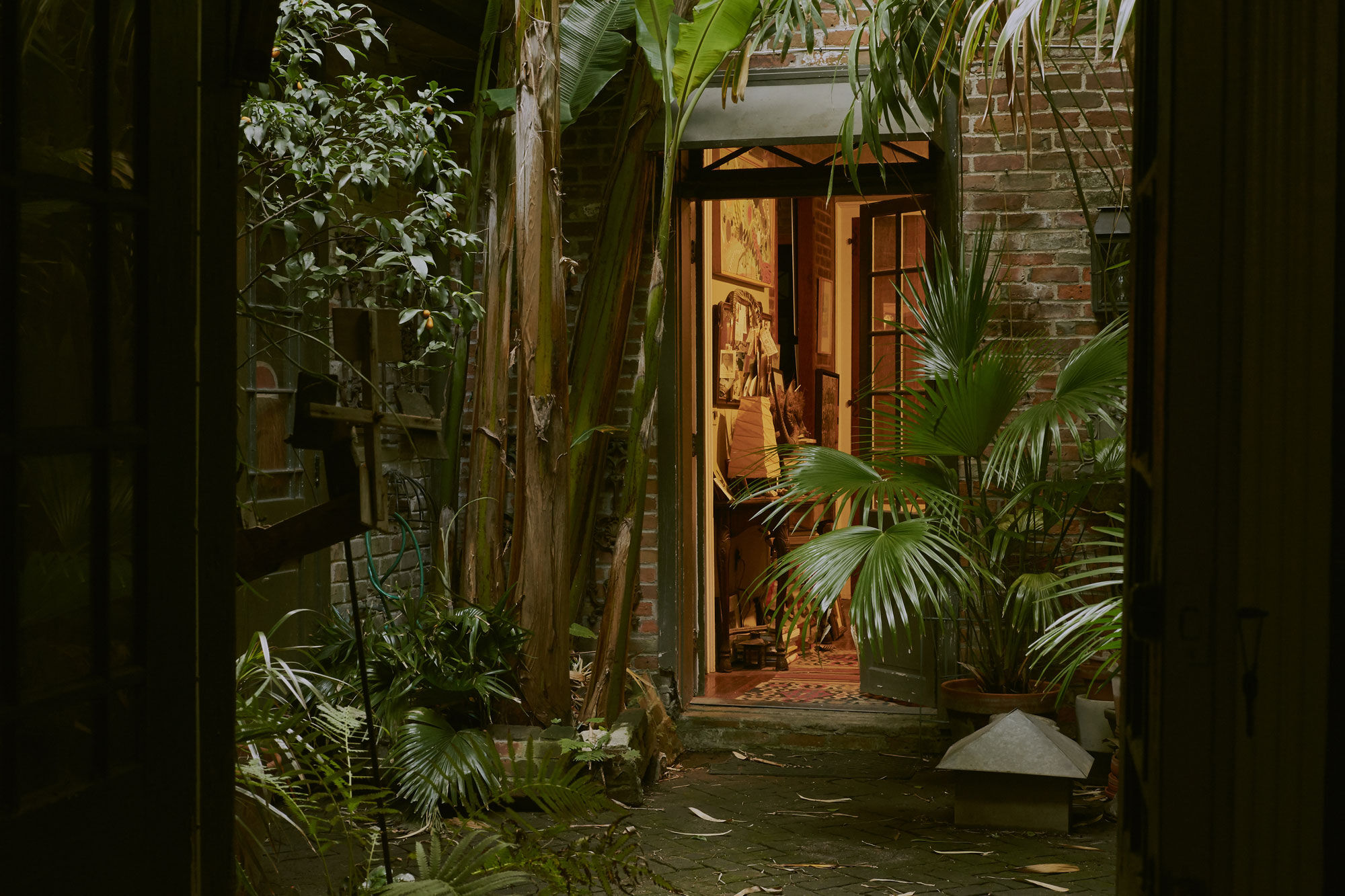 At the center of Fagaly's home in the French Quarter of New Orleans, a courtyard demonstrates the power of the spell that so many fall under in this city. Birds of paradise and palmettos stake out the edges of garden punctuated by French doors that lead into the space, providing a respite from the busy streets. Photo by Michael Adno for Artsy.