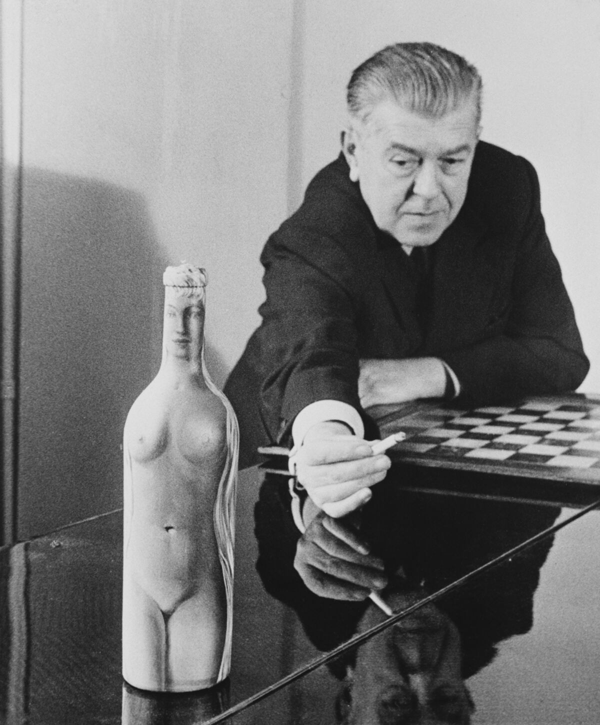 René Magritte with Femme-Bouteille, c. 1955. Photo by Archive Photos/Getty Images