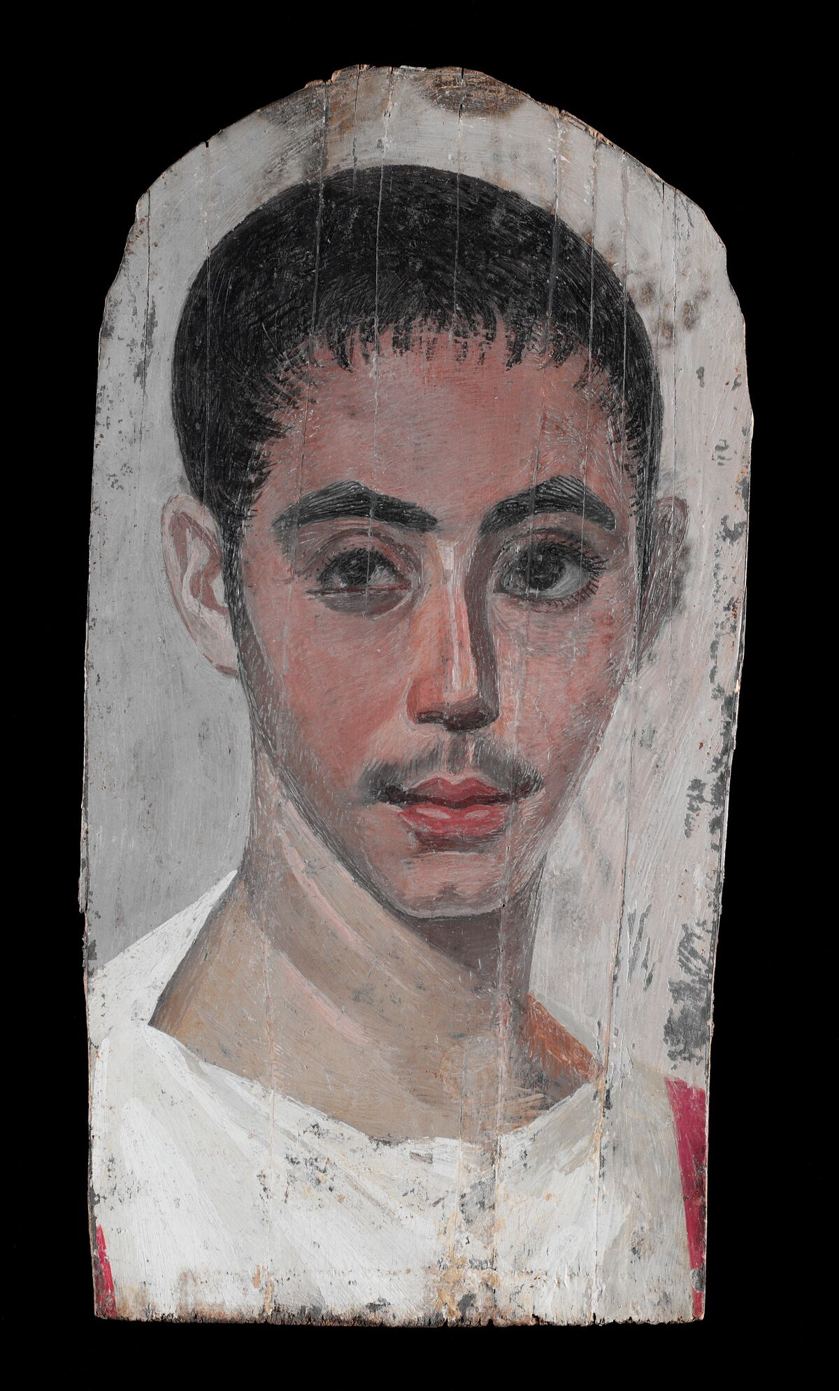 Portrait of a Youth with a Surgical Cut in one Eye, 190–210 C.E. Courtesy of The Metropolitan Museum of Art.
