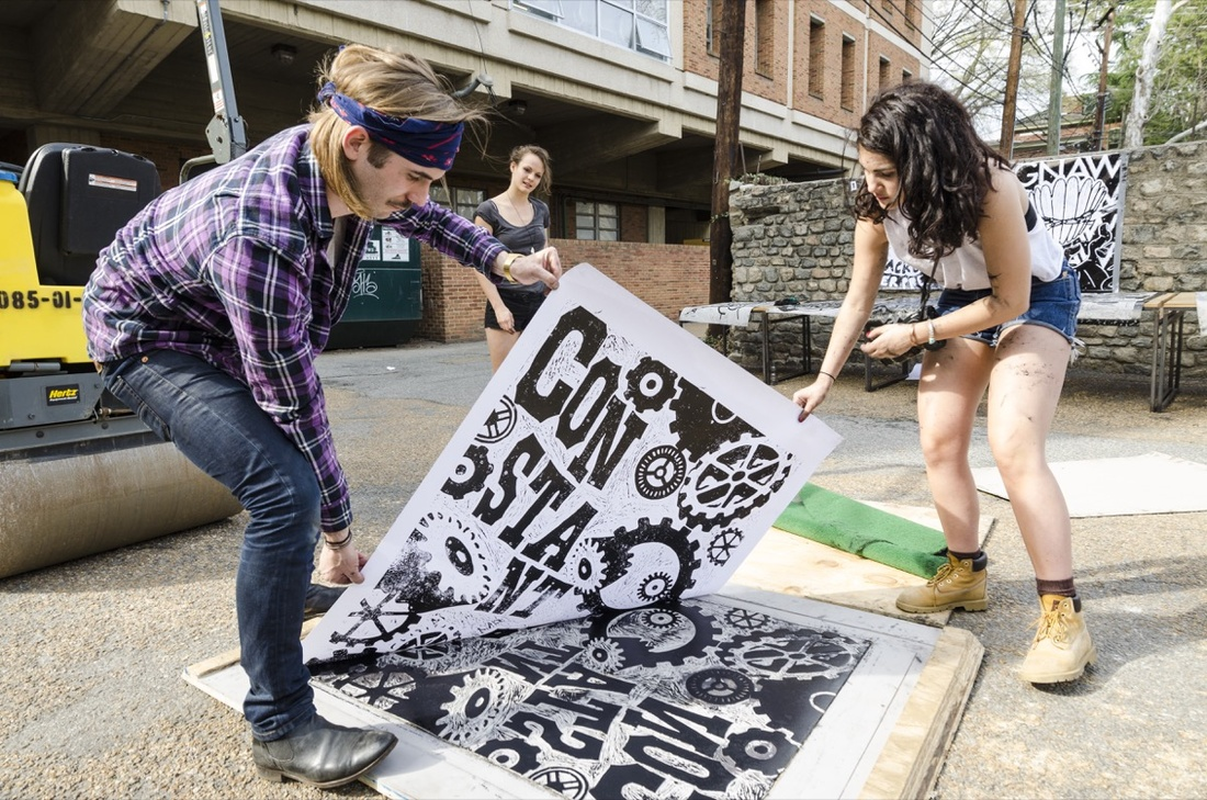 Graphic design students printing with a steamroller. Courtesy of VCUarts.