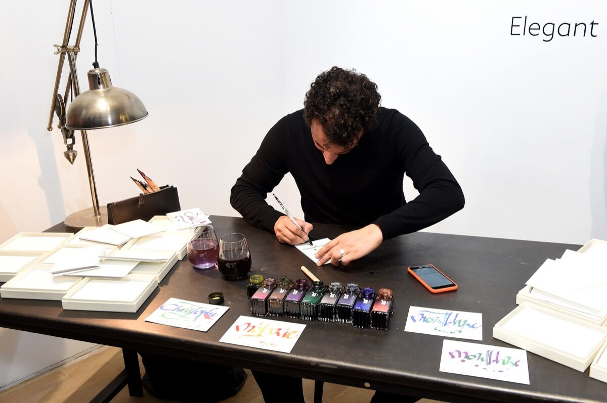 Calligraphy demonstration by Nicolas Ouchenir. Photo by Stephane Cardinale - Corbis / Corbis via Getty Images for Montblanc.