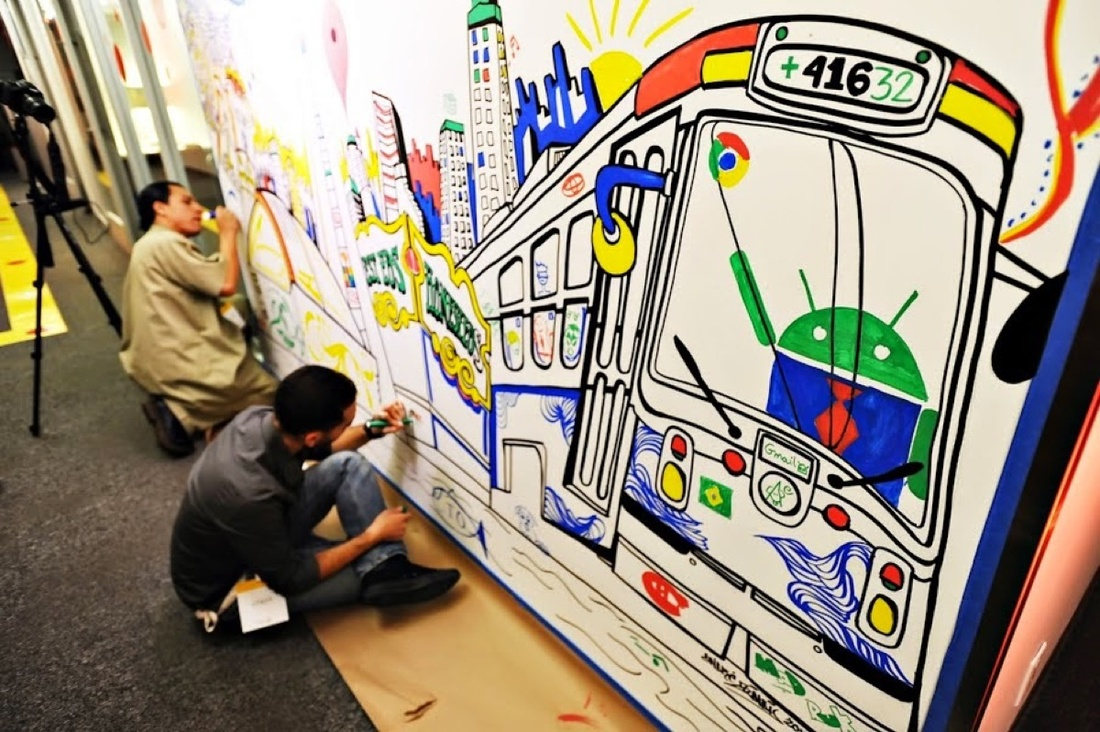 Local artists work on a mural in Google's Toronto, Canada office. Photo via Google.