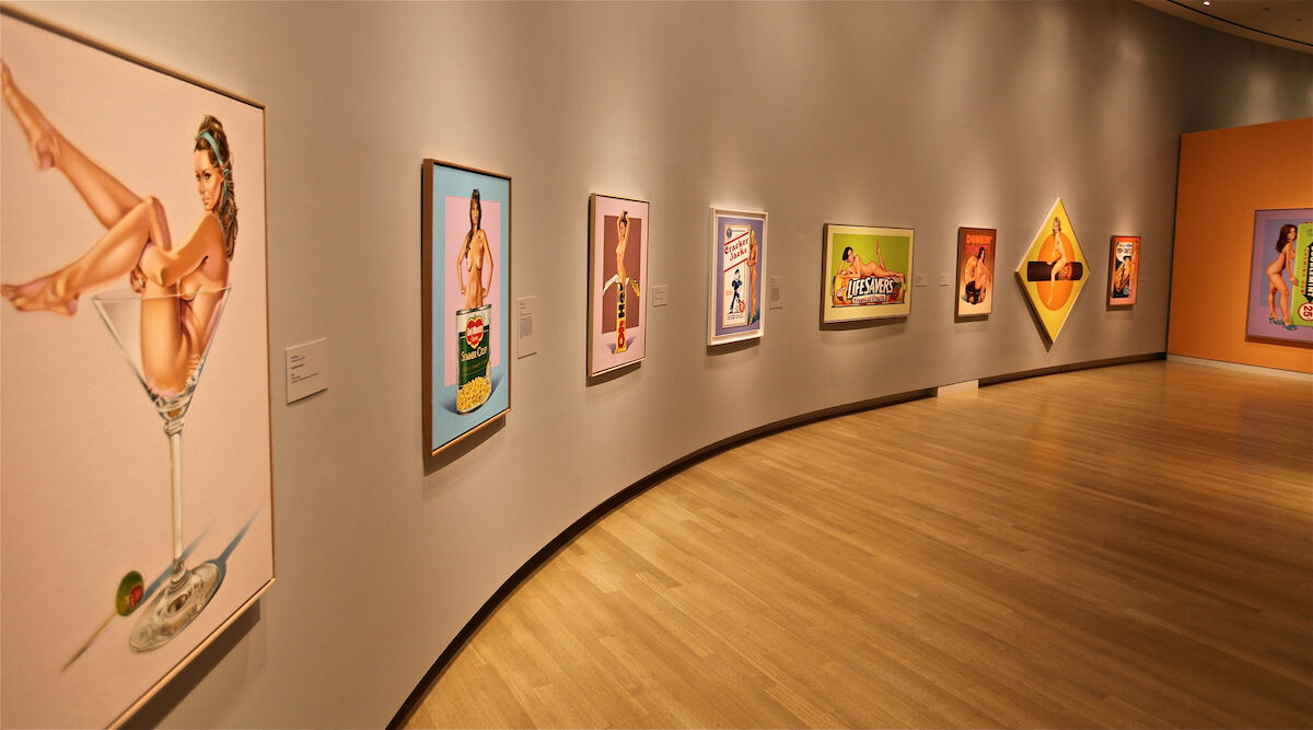 "Installation view of ""Mel Ramos: 50 Years of Superheroes, Nudes, and Other Pop Delights"" at the Crocker Art Museum. Photo by lar3, via Flickr."