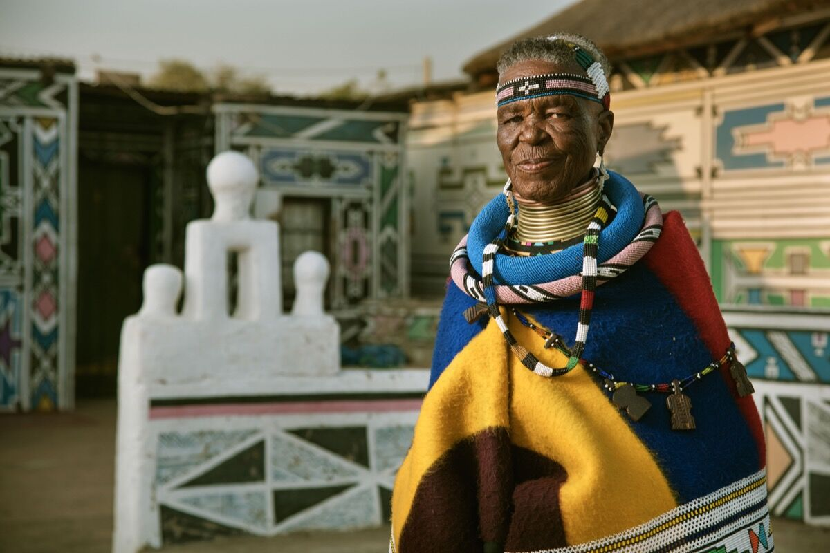 Esther Mahlangu in front of her house in Middelburg, province of Mpumalanga, South Africa, 2016. Photo courtesy of BMW.