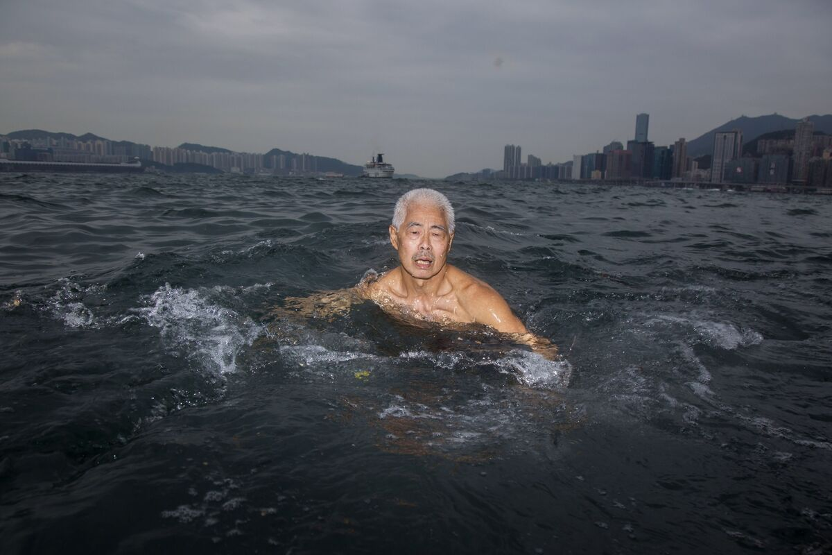 Chan Hak-chi goes swimming in Hong Kong, on May 25, 2017.  Photo by  Yue Wu. Courtesy of the artist.