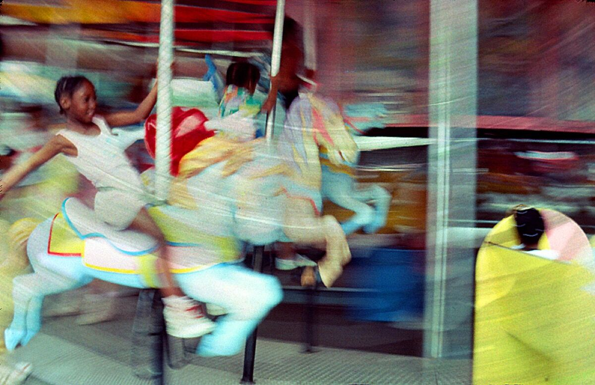 Lynn Hyman Butler, Girl on a Merry-Go-Round,  ca. 1989. © Lynn Hyman Butler. Courtesy of the artist.