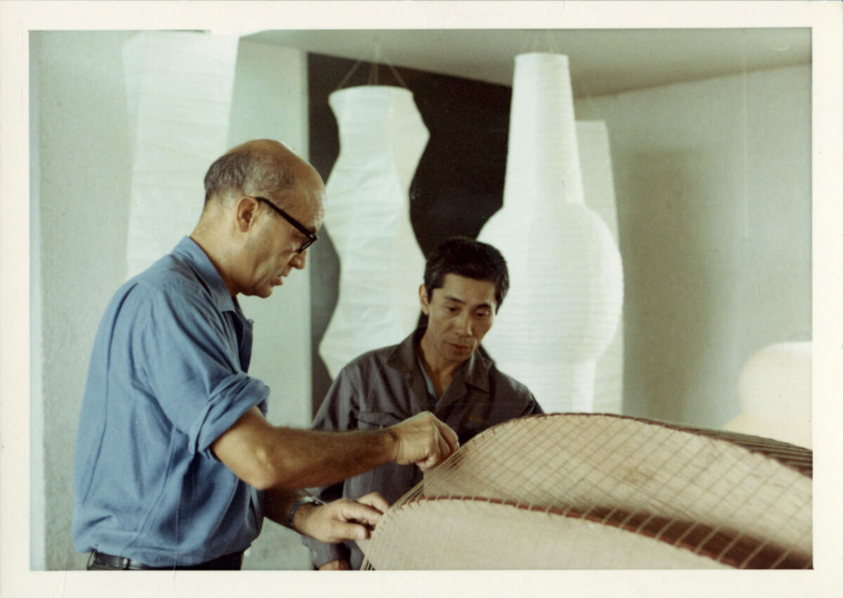 Isamu Noguchi working on Akari in Japan, 1968. © The Isamu Noguchi Foundation and Garden Museum / Artists Rights Society (ARS). Courtesy of The Noguchi Museum