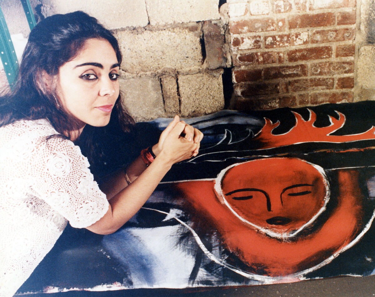 Shirin Neshat with one of her paintings circa 1980s. Courtesy of the artist and Gladstone Gallery, New York and Brussels.