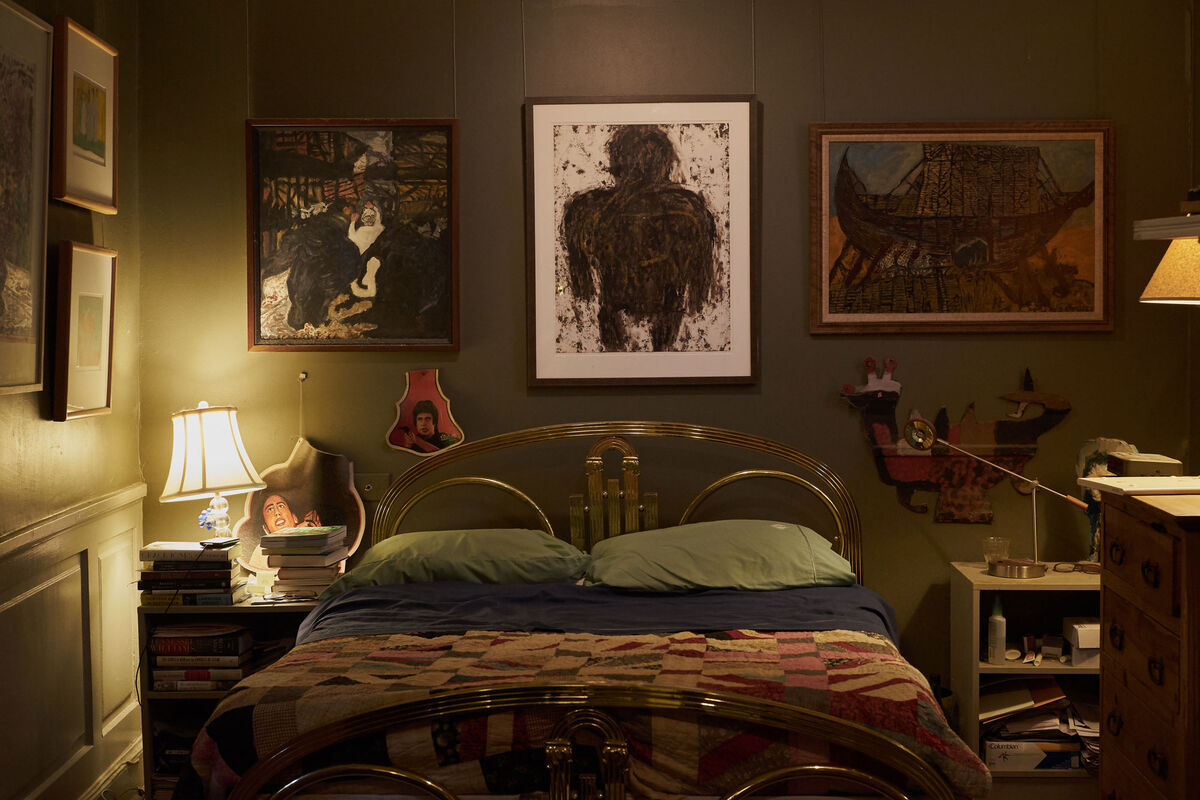 Works by Justin McCarthy depicting Noah's Ark (left and right), David Butler (right of headboard), and Michel Nedjar hang in Fagaly's bedroom. Works by self-taught and formally trained artists from France, Ghana, India, and New Orleans populate the room in a refreshing sense of what's worth living with. Photo by Michael Adno for Artsy.