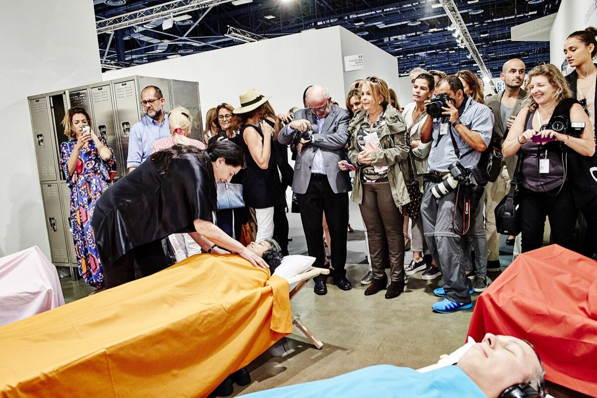 Marina Abramovic, Sleeping Exercise at Art Basel in Miami Beach, 2014. Photo by Mark Niedermann.