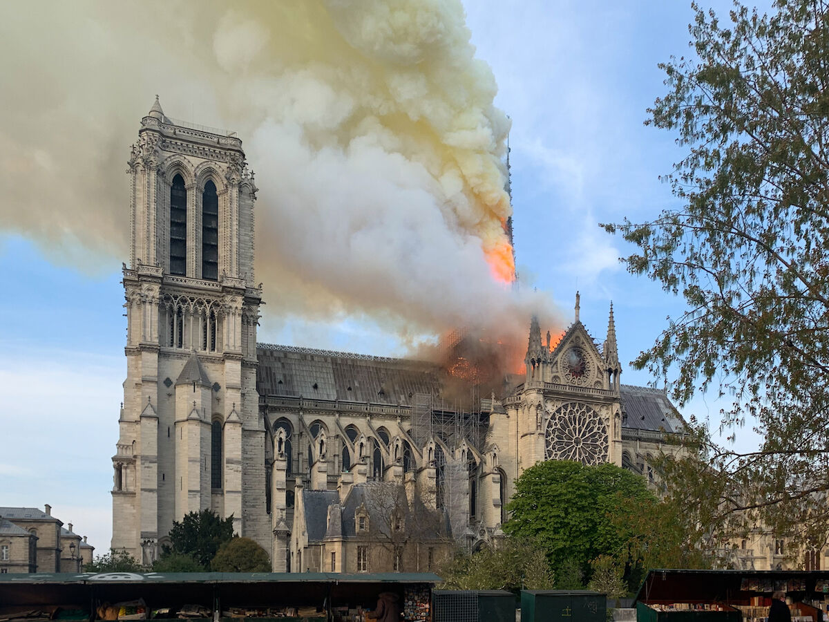 The spire of Notre Dame Cathedral on fire on April 15, 2019. Photo by Wandrille de Préville, via Wikimedia Commons.