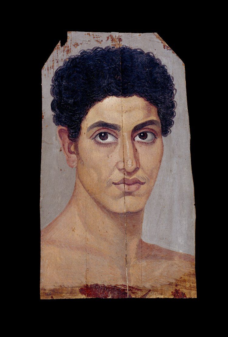 Limewood panel bearing portrait in encaustic and tempera of naked young man with curly hair, 80-120. Courtesy of the British Museum.