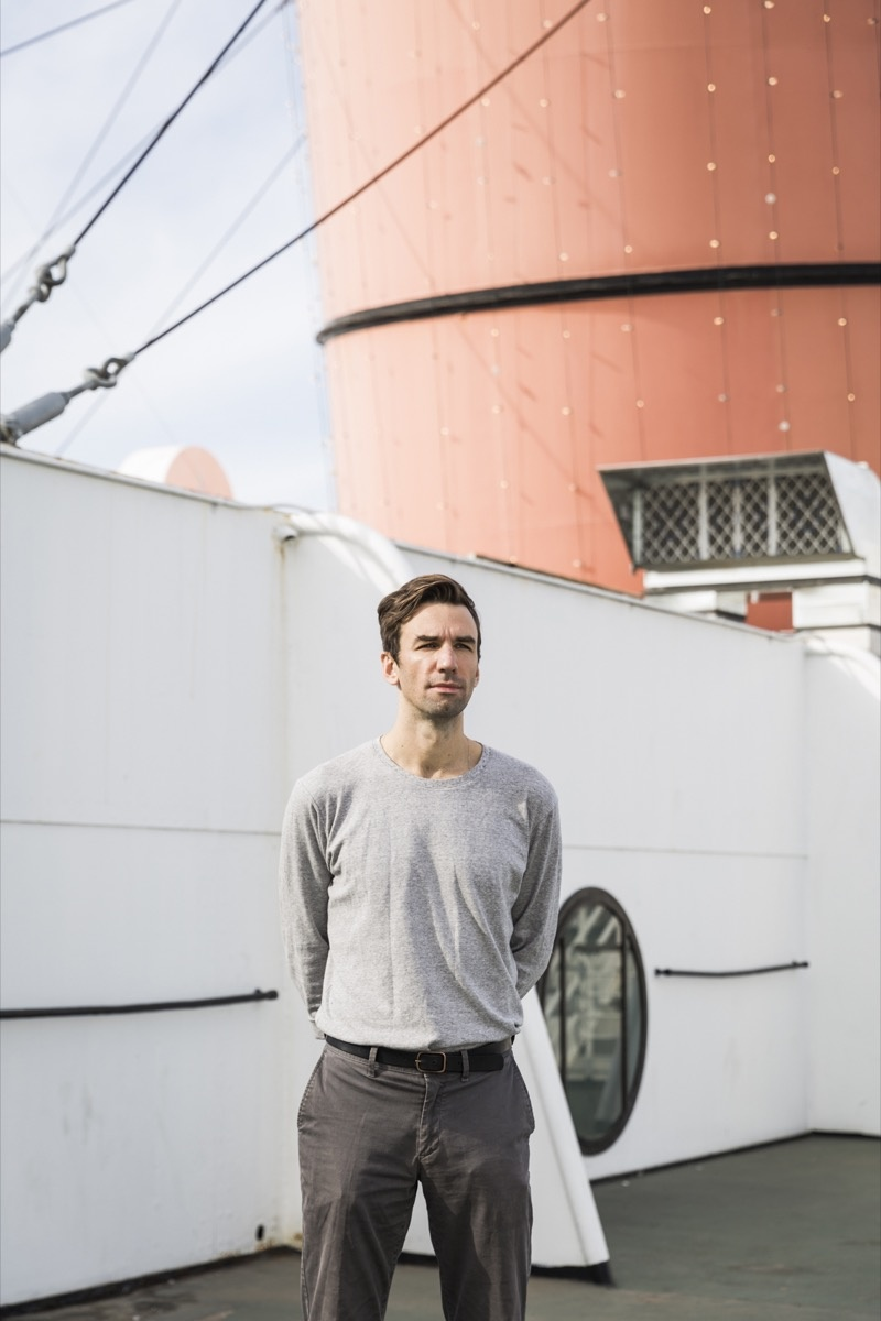 Portrait of Andrew Norman Wilson on the RMS Queen in Long Beach, California, by Emily Berl for Artsy.