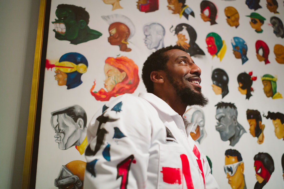 Portrait of Amar'e Stoudemire with a work by Hebru Brantley in his Miami home by Gesi Schilling for Artsy.