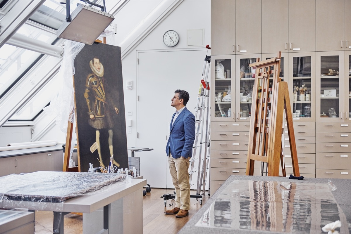 Narayan Khandekar stands in front of a 17th-century Spanish painting that may contain Mummy Brown. Photo by Tony Luong for Artsy.
