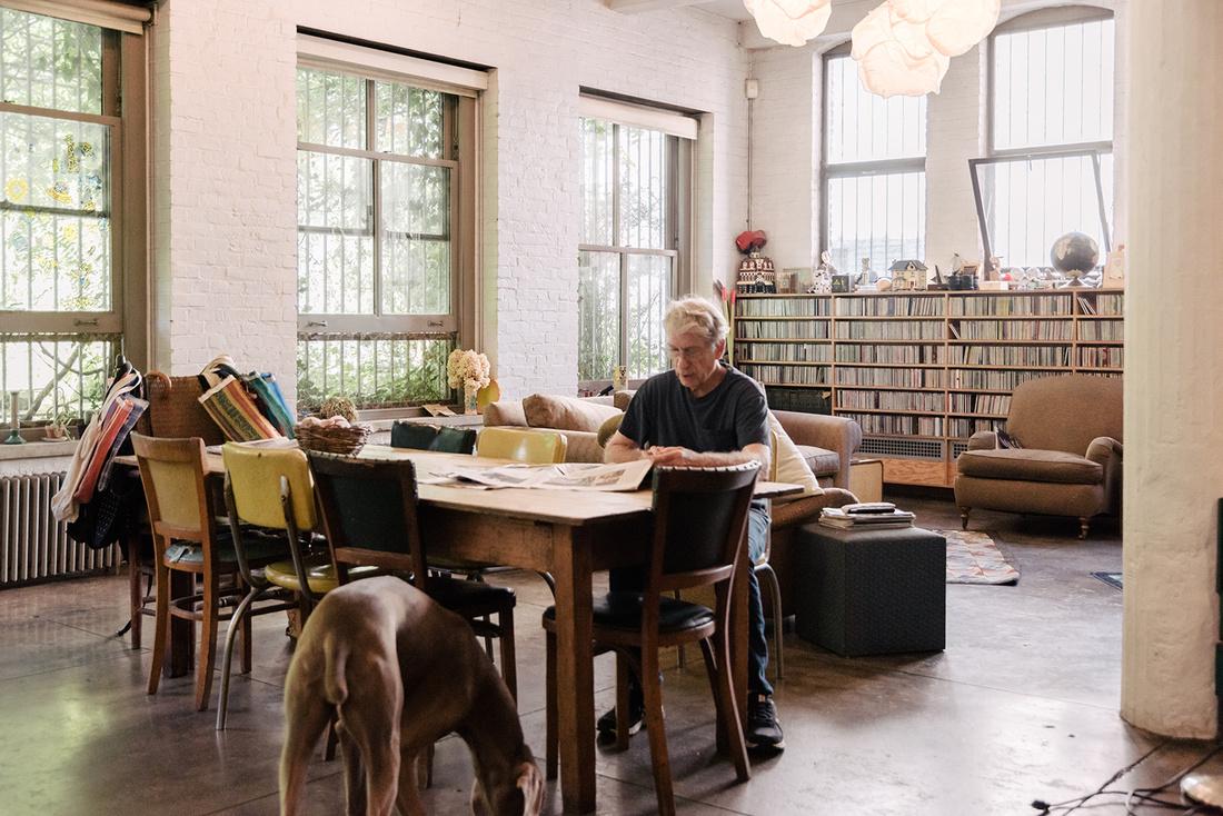 Portrait of William Wegman in his New York home and studio by Daniel Dorsa for Artsy.