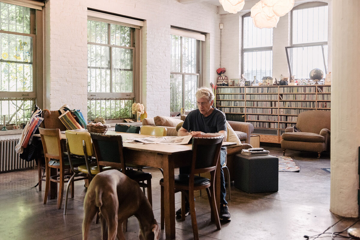 Portrait of William Wegman in his New York home and studio by Daniel Dorsa for Artsy.