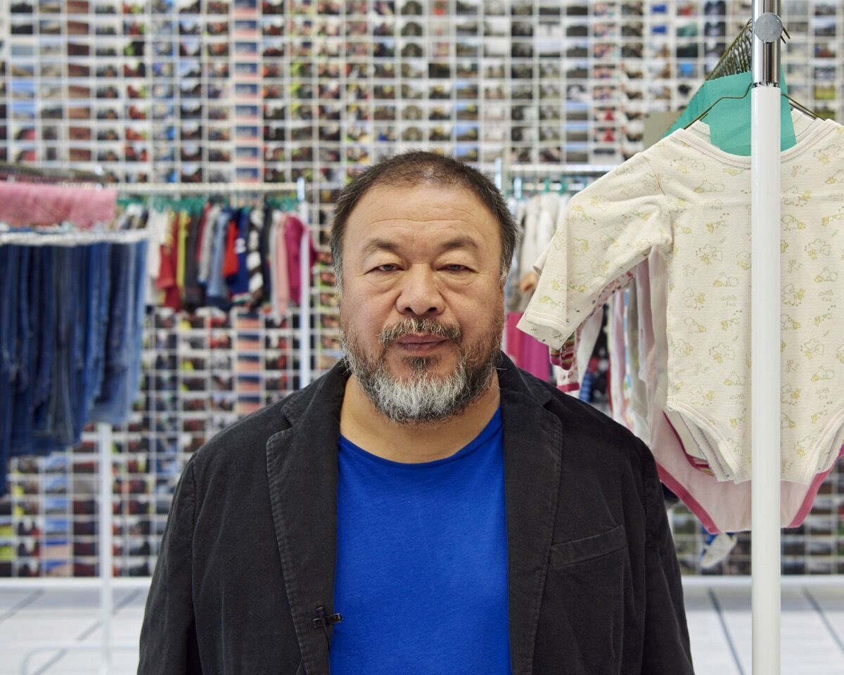 "Ai Weiwei, November 4, 2016, with his installation ""Laundromat,"" 2016, at Jeffrey Deitch, New York. Portrait by Jason Schmidt."