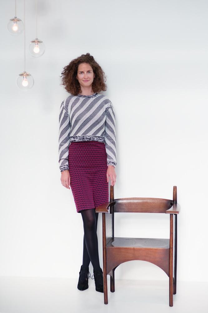 Specialist Sofia Sayn-Wittgenstein poses in front of Charles Rennie Mackintosh's armchair