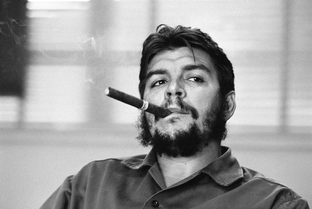René Burri, Ministry of Industry. Ernesto Guevara (Che), Argentinian politician, Minister of industry (1961-1965) during an exclusive interview in his office, 1963. Courtesy of Magnum Photos.