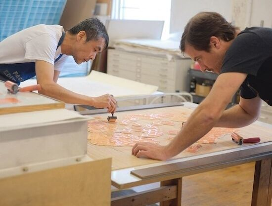 Printers Yasu Shibata and Justin Israels at the Pace Editions workshop in Manhattan. Image Courtesy of Pace Prints.