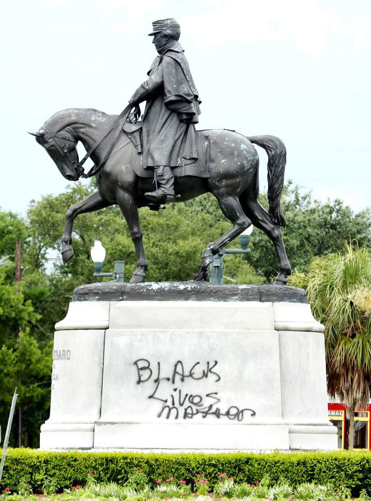 Statue of Confederate Gen. Beauregard in New Orleans with graffiti.