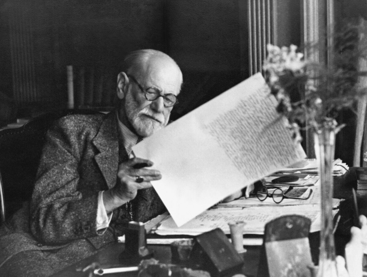 Sigmund Freud at his desk in his Vienna home. Photo via Getty Images.