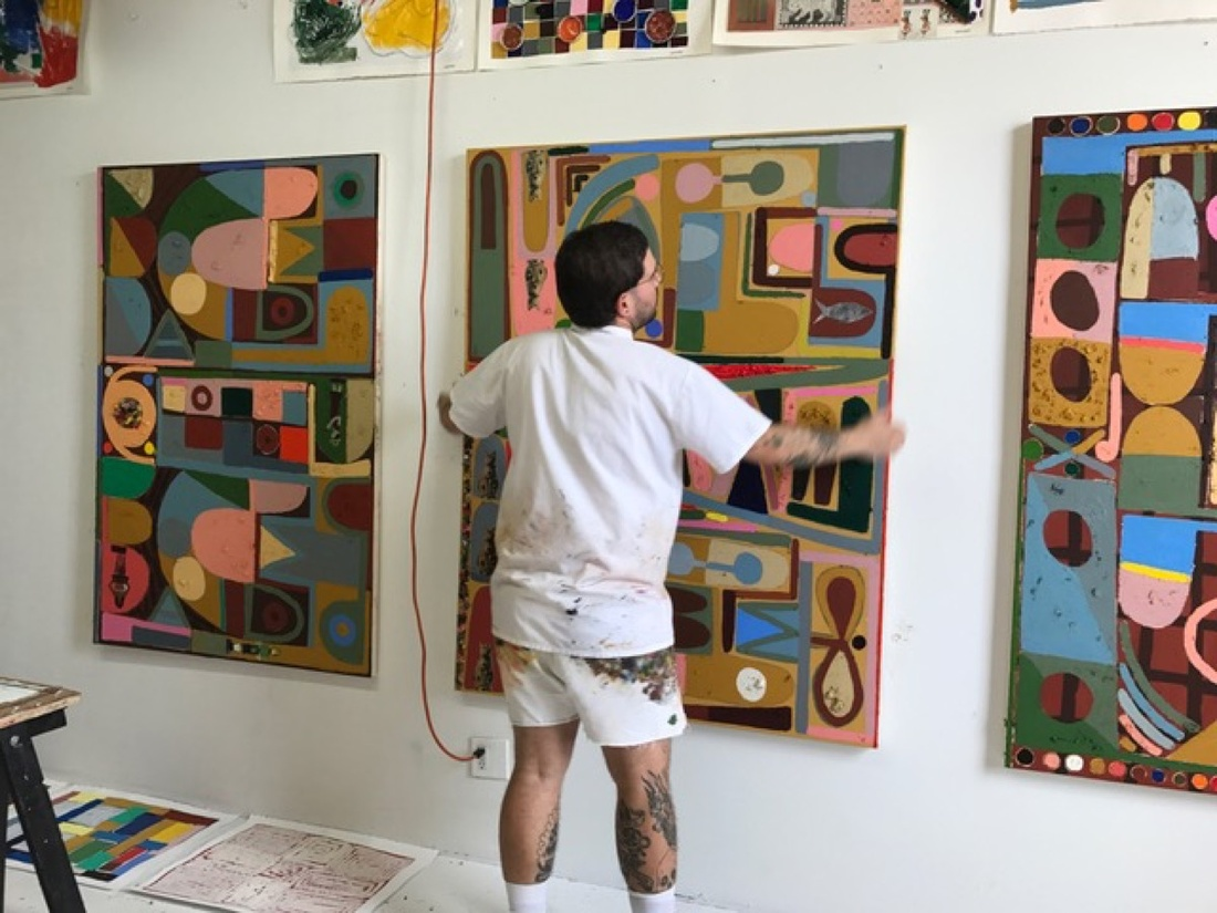 Austin Eddy in his studio with paintings destined for his one-night exhibition. Courtesy of Half Gallery.