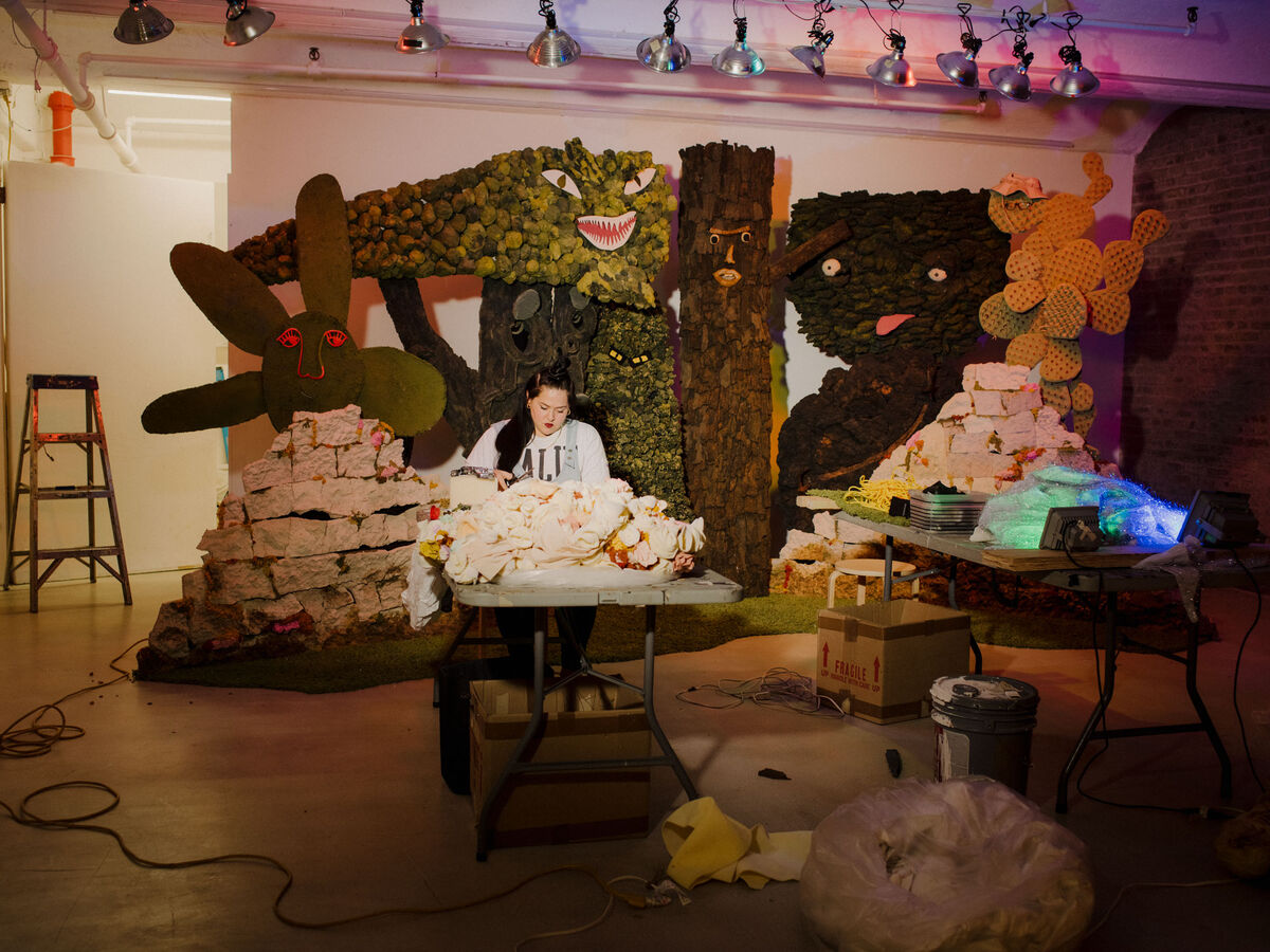 Jaimie Warren at work inside American Medium gallery, with the foam forest that served as the backdrop for her performance Love's In Need of Love Today, 2018. Photo by Heather Sten for Artsy.
