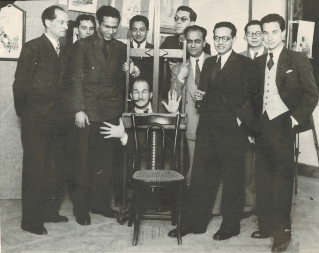 Art and Liberty, 1941. Front row, left to right: Jean Moscatelli, Kamel el Telmissany, Angelo de Riz, Ramses Younan, Fouad Kamel. Back row, left to right: Albert Cossery, unidentified, Georges Henein, Maurice Fahmy, Raoul Curiel. Image courtesy of Centre Pompidou.