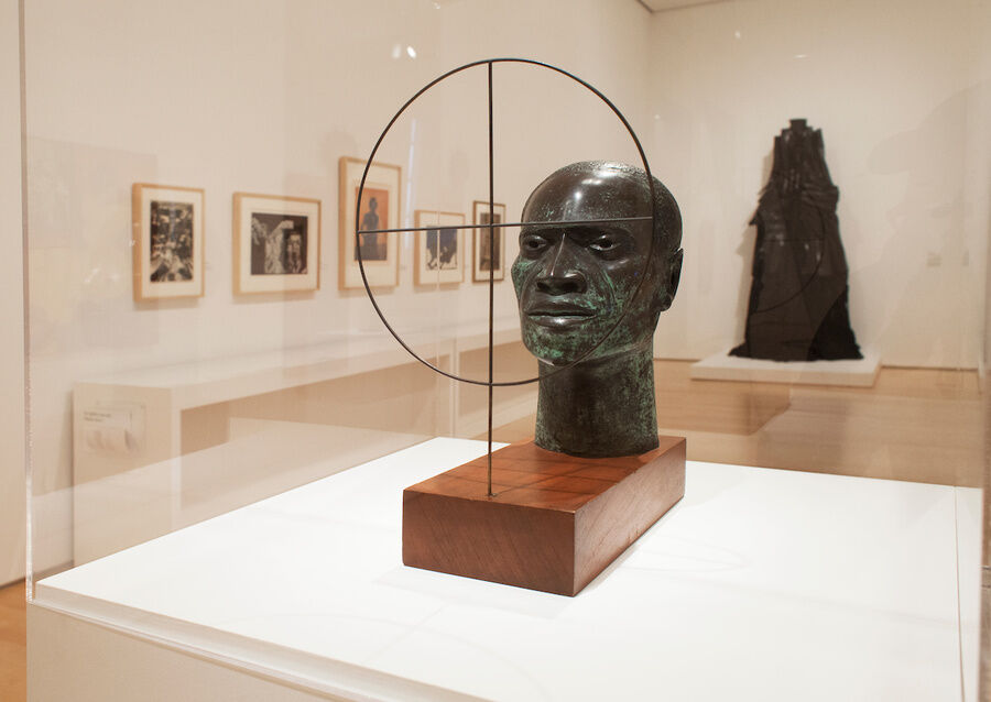 "Installation view of Elizabeth Catlett, Target, 1970, and Barbara Chase-Riboud's, Confessions for Myself, 1972 in ""We Wanted A Revolution."" © Jonathan Dorado. Courtesy of the Brooklyn Museum."