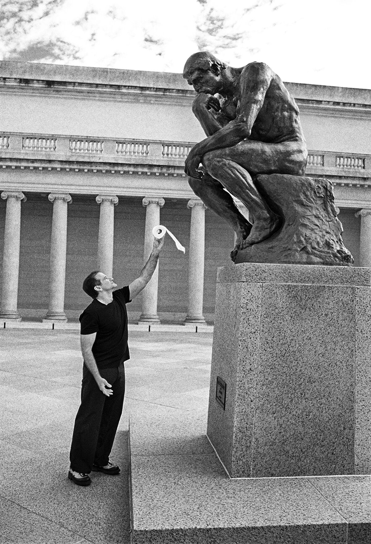 Robin Williams with Auguste Rodin's The Thinker. Photo by and copyright Arthur Grace, courtesy Sotheby's.