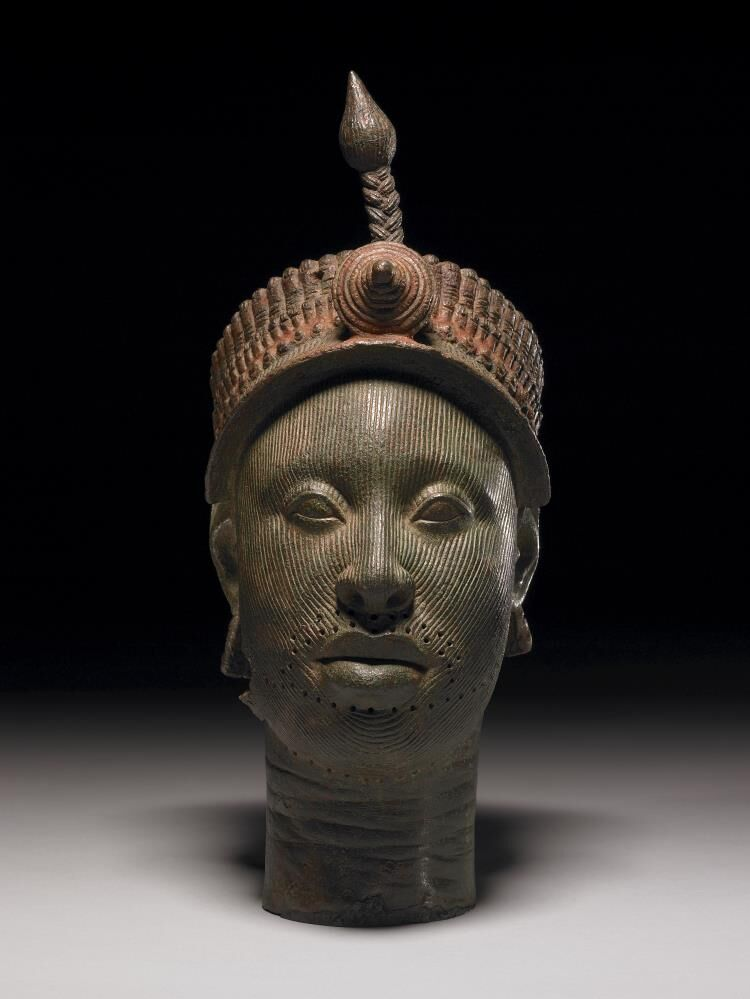 The Ife Head, ca. 14th-15th Century. Head representing ruler (with elaborate head-dress) made of brass. Image via the British Museum.