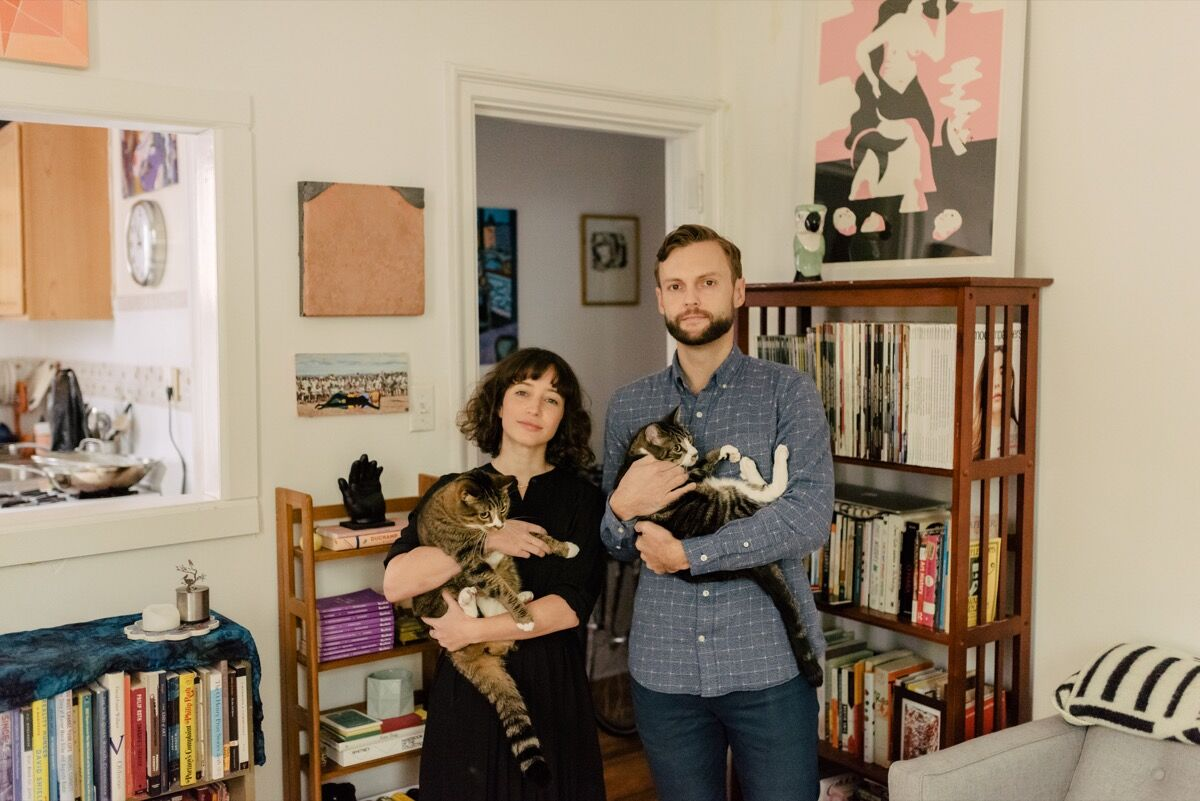 Ariela Gittlen and Scott Indrisek of Teen Party in their apartment with artworks by Davina Semo, Devin Troy Strother, and Daniel Zender. Photo by Daniel Dorsa for Artsy.