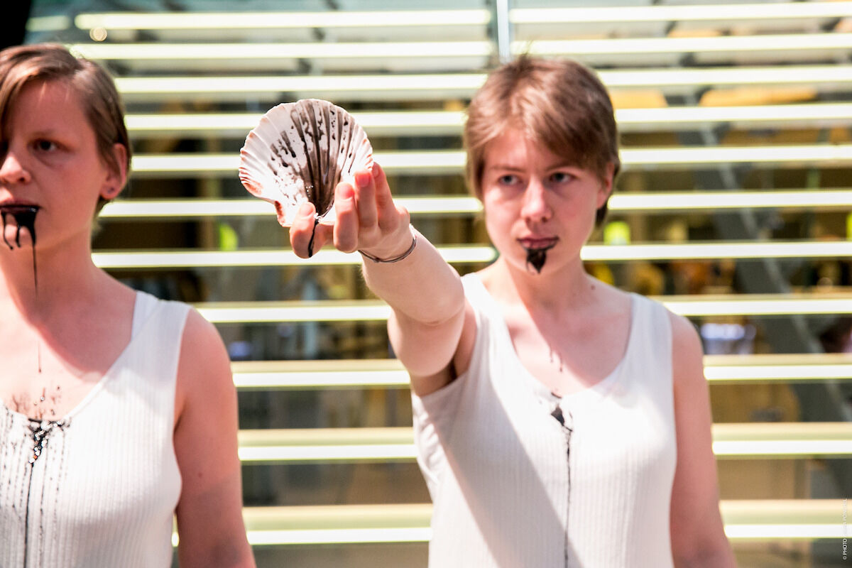 """Fossil Free Culture NL's 2017 performance """"Drop the Shell"""" at the Van Gogh Museum in Amsterdam. Photo by Laura Ponchel, courtesy Fossil Free Culture NL."""