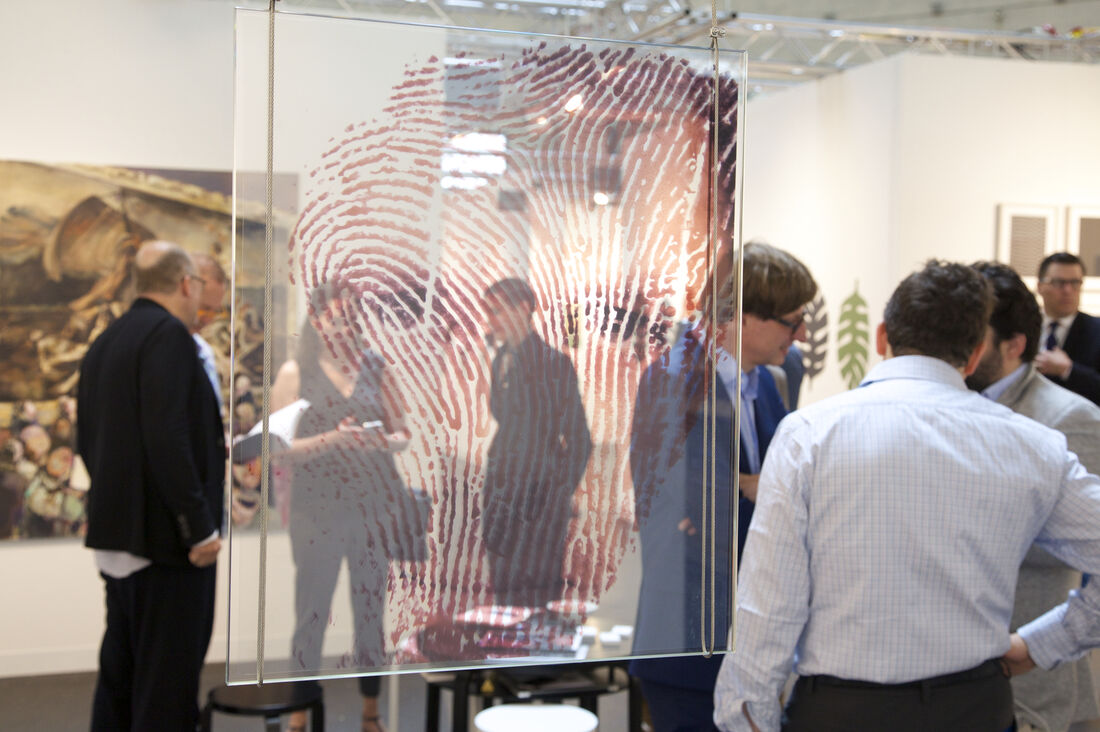 "Hubertus Hamm's ""fingerprint portrait"" reflects upon his Galerie Kornfeld's (Berlin) booth, featuring further experimental portrait photography by the artist as well as new paintings by Franziska Klotz on the far wall. Courtesy VOLTA13."