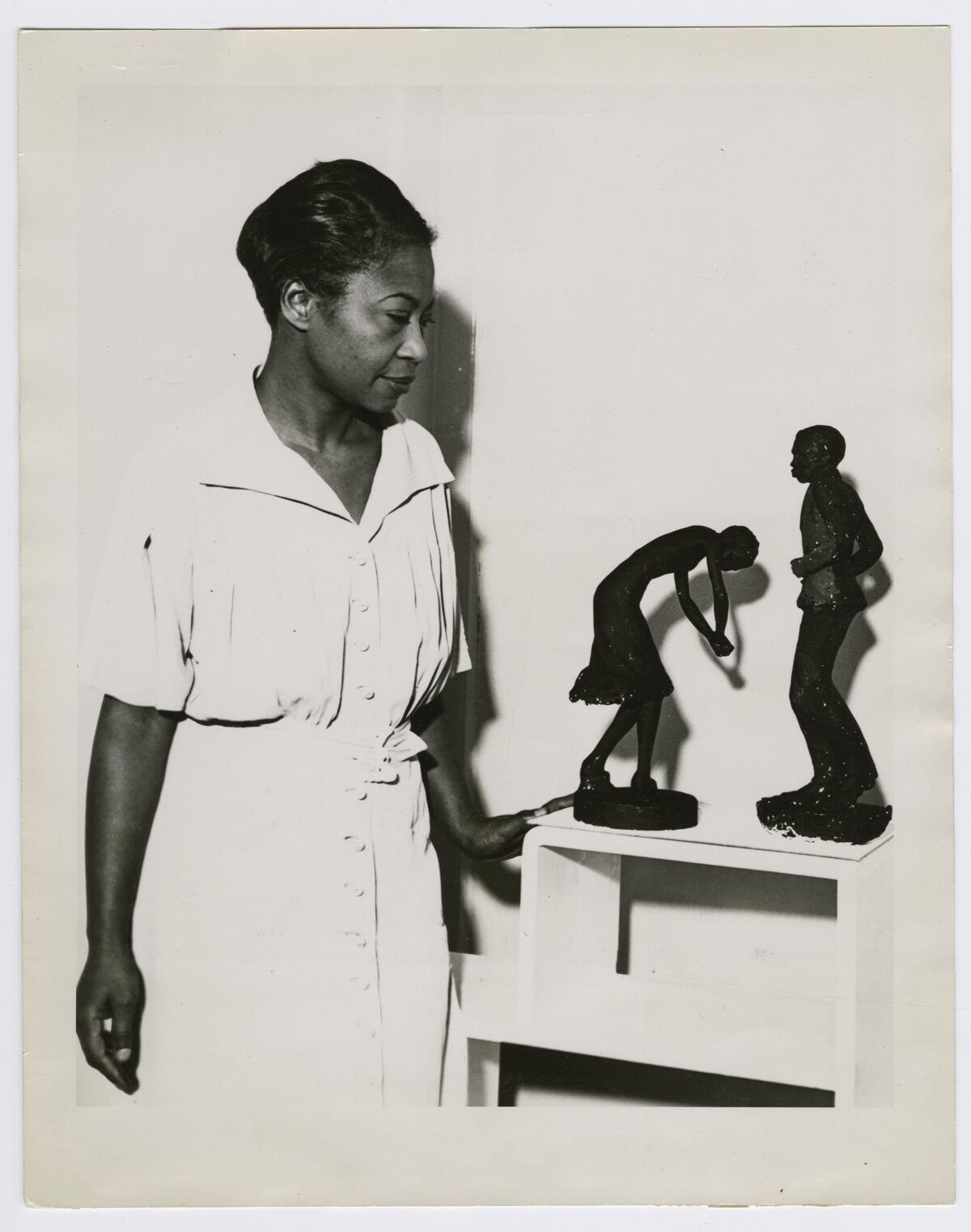 Augusta Savage viewing two of her sculptures, Susie Q and Truckin, 1939.  Courtesy of the Schomburg Center for Research in Black Culture, NYPL.