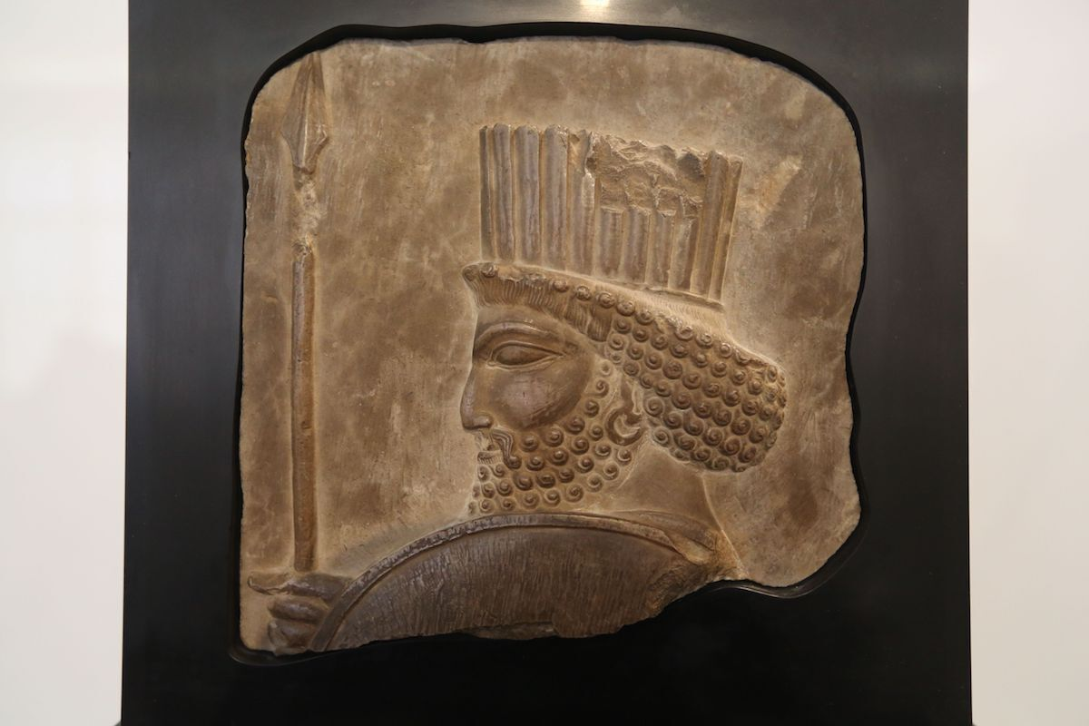 A twice-stolen ancient Persian artifact in Tehran's national museum after a New York court ordered it returned to Iran. The bas-relief, approximately 25 centuries old, depicts the head of a soldier from a line of Immortal Guards. Photo by Atta Kenare/AFP/Getty Images.