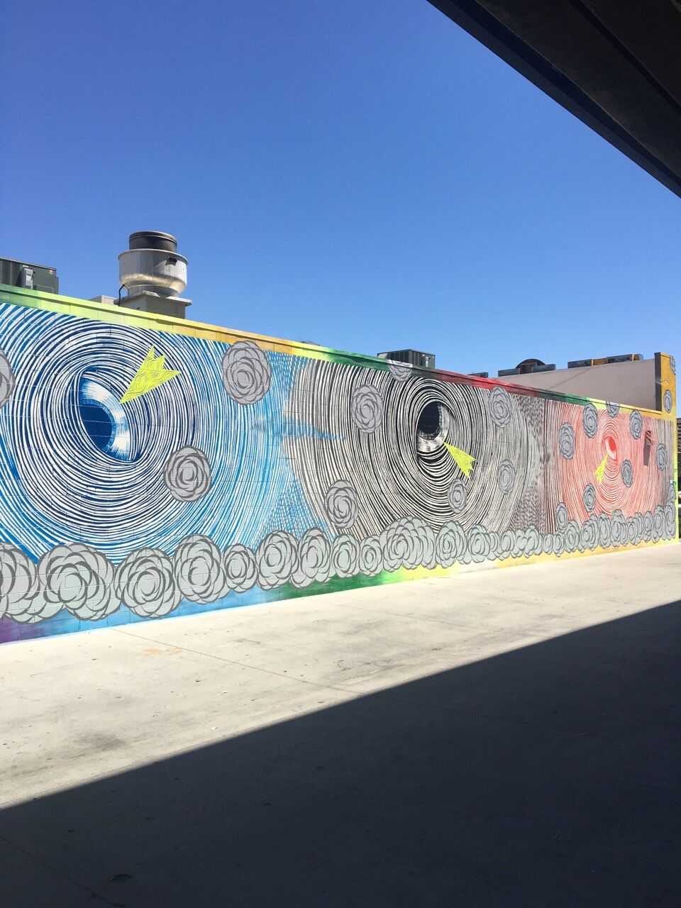 Optical Vortex (Spinning Eyes), 2016; Acrylic on wall; 12 x 30 x 6 feet; Courtesy of the artist and Hosfelt Gallery