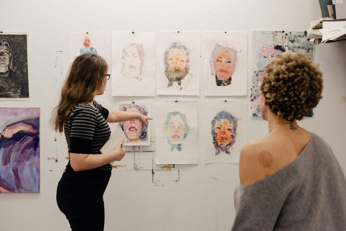 MFA student Liza Sokolovskaya and Amy Sherald during a studio critique at New York Academy of Art. Photo by Daniel Dorsa for Artsy.