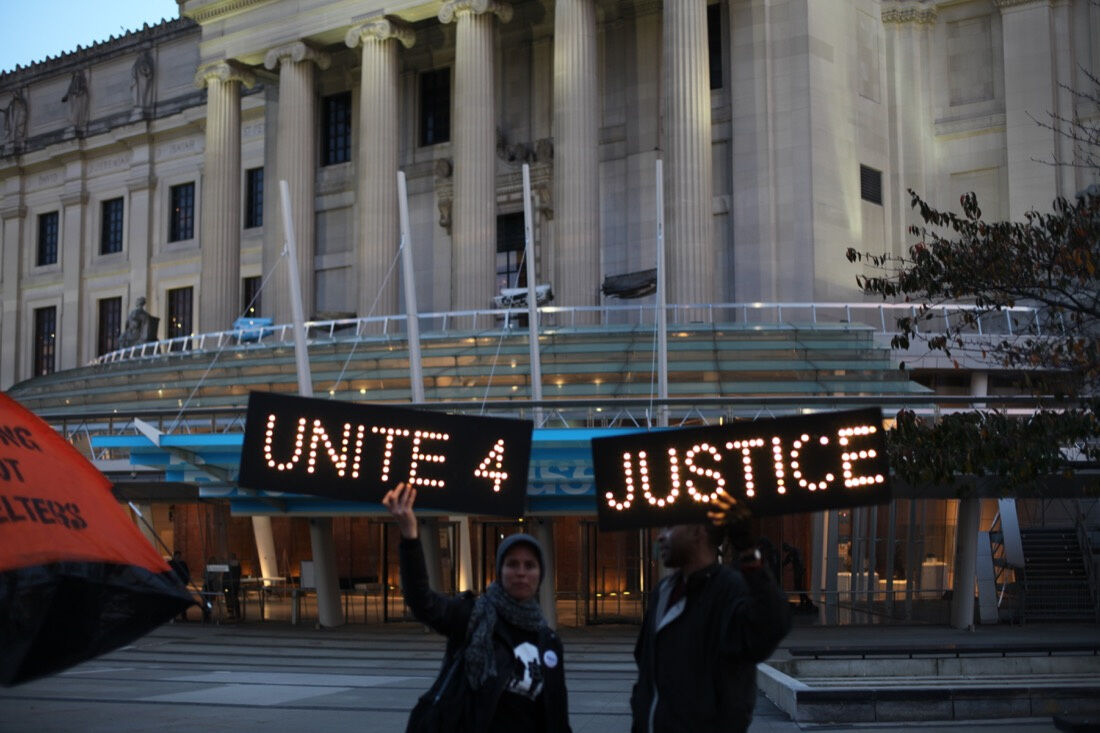 Protests in front of the Brooklyn Museum on Tuesday, Nov. 17, 2015. Photo by Isaac Kaplan for Artsy.
