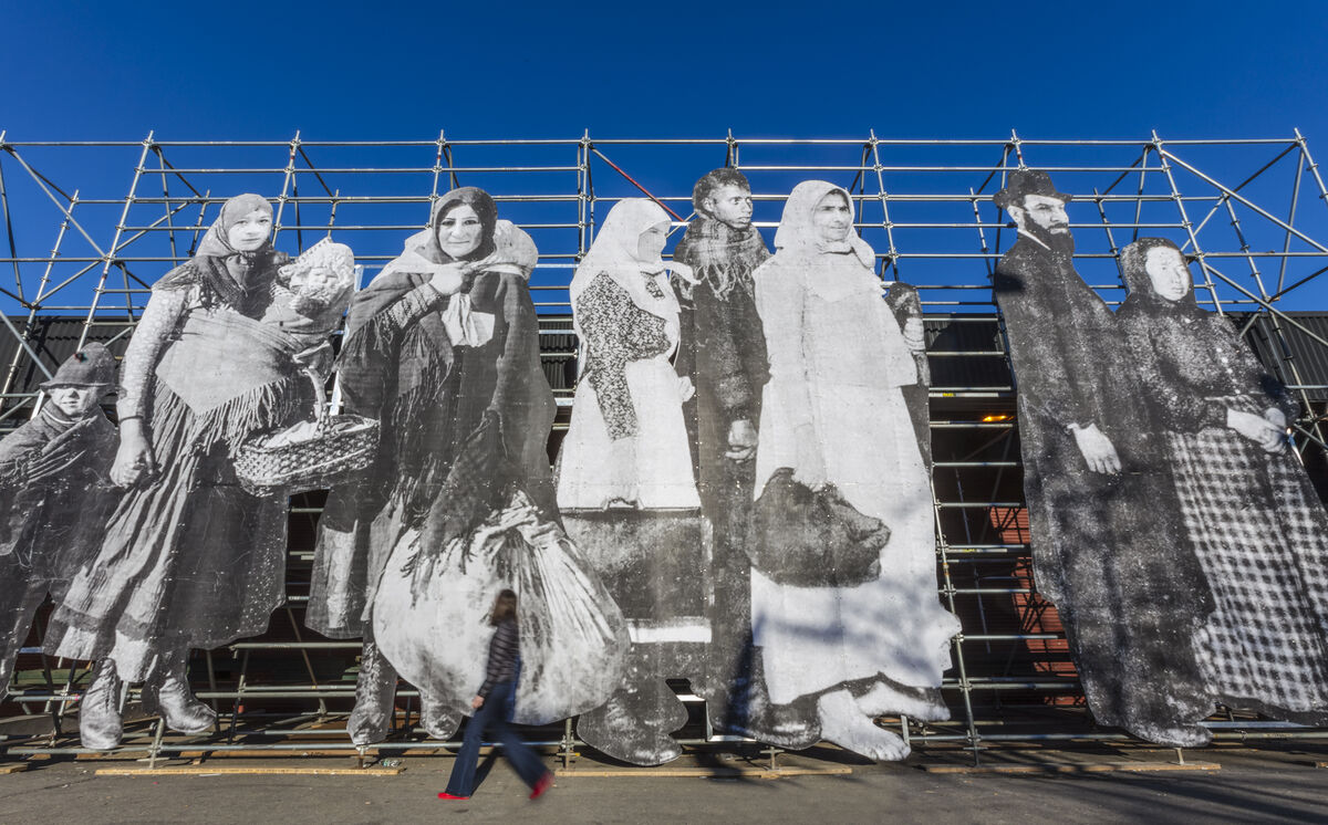 JR Mounts a Towering Monument to Refugees at The Armory Show
