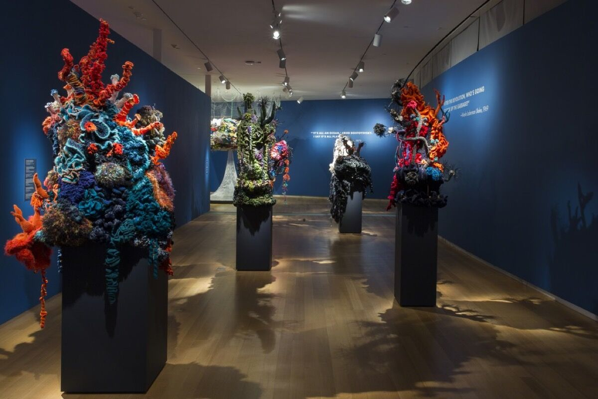 "Installation view of ""Crochet Coral Reef: TOXIC SEAS,"" 2016. Photo by Jenna Bascom, courtesy of the Museum of Arts and Design."