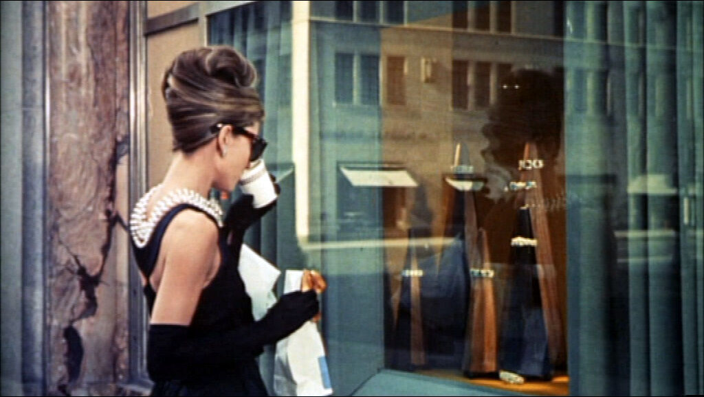 Audrey Hepburn in Breakfast at Tiffany's. Image via Wikimedia Commons.