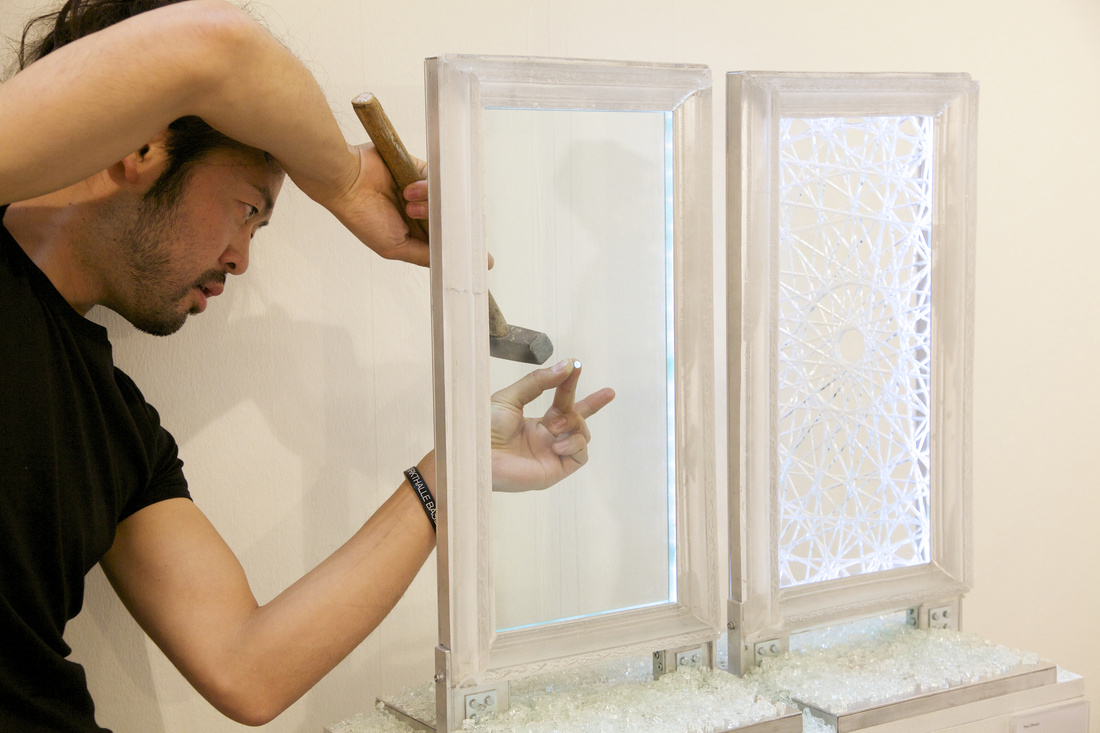 "Tets Ohnari (exhibiting with Tezukayama Gallery, Osaka) sets up his performance action blink, which in an instant will crack the glass pane to ""activate"" and complete the piece; Courtesy VOLTA13"