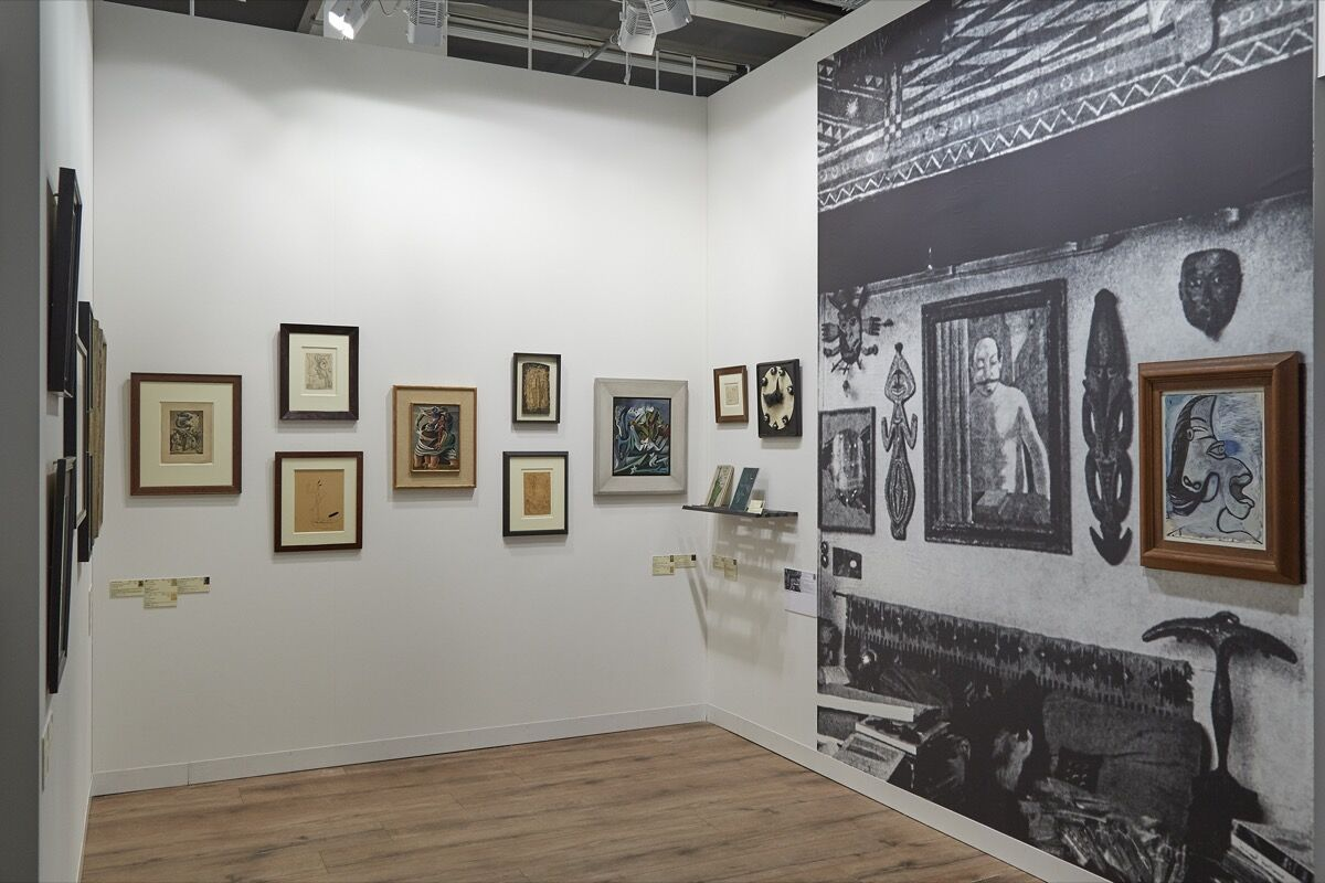 Installation view of Galerie 1900–2000's booth at Art Basel, 2017. Photo by Benjamin Westoby for Artsy.