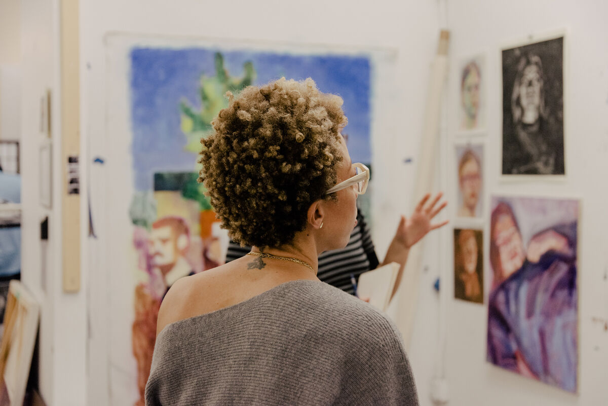 Portrait of Amy Sherald during a studio critique at New York Academy of Art. Photo by Daniel Dorsa for Artsy.