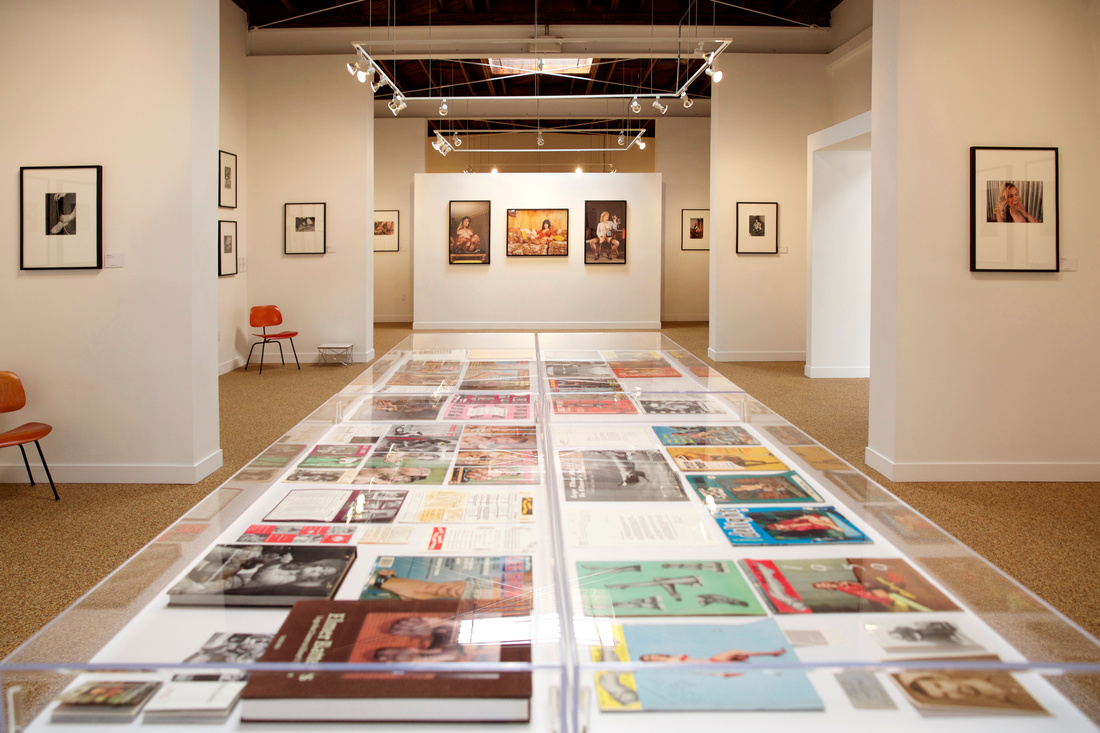 """Installation view of """"Bizarre Life – The Art of Elmer Batters & Eric Stanton,"""" courtesy of TASCHEN"""