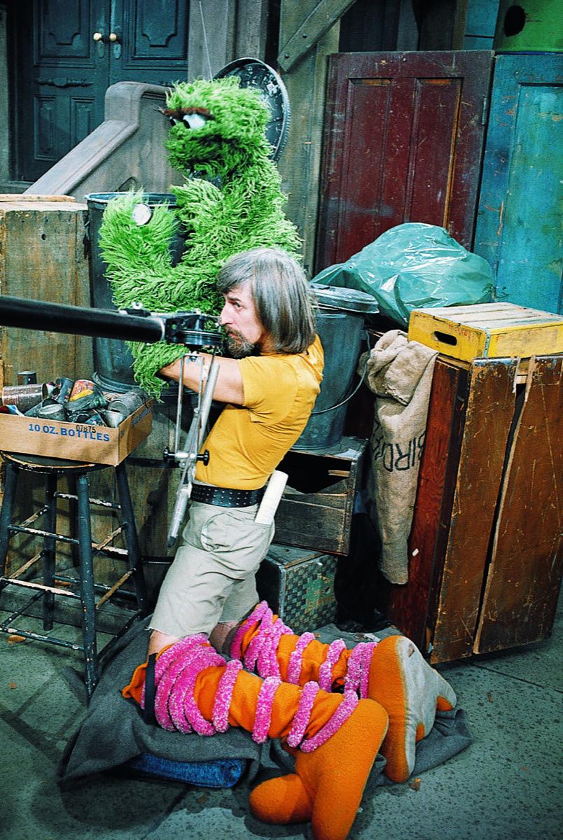 Caroll Spinney performing Oscar while in his Big Bird legs. Courtesy of Sesame Workshop.