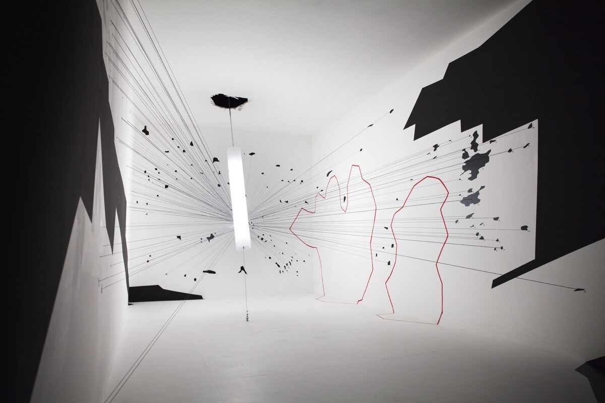A full-scale reconstruction of the targeted room in which the blast occurred, enabled by the occasion of the 2016 Venice Biennale of Architecture. Photo by Matthias Böttger. Courtesy of Forensic Architecture.